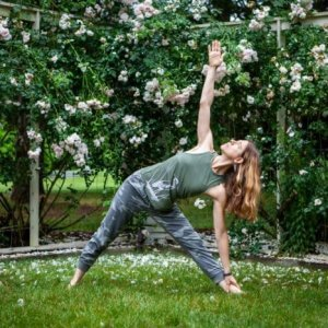 yoga pose in front of roses
