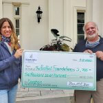 Owner of Starr Mill Yoga presents check to Rockfall